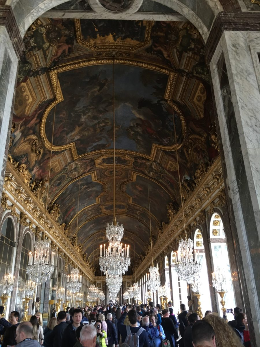 The Hall of Mirrors, one of the Palace's most famous rooms, hectically busy.